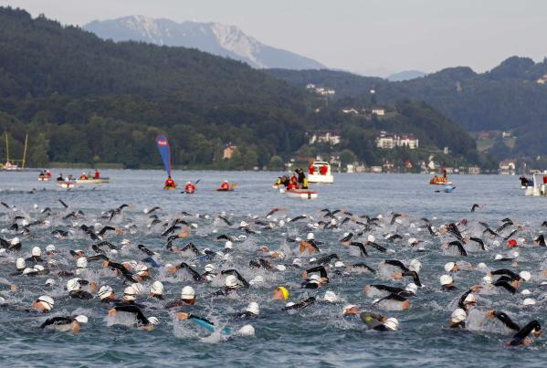 1413649519-competitors-swim-during-ironman-austria-triathlon-race-klagenfurt
